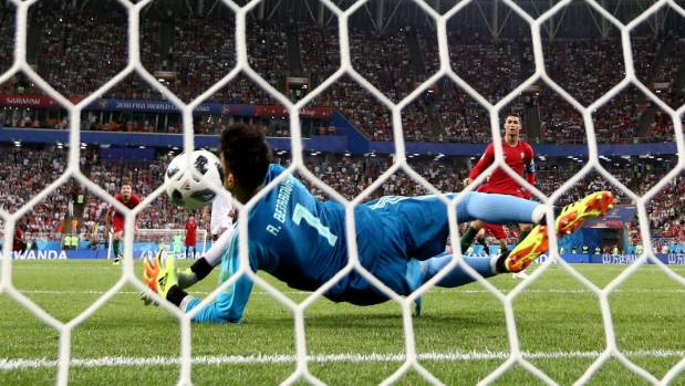 Cristiano Ronaldo looks on as Iran keeper Alireza Beiranvand makes the save