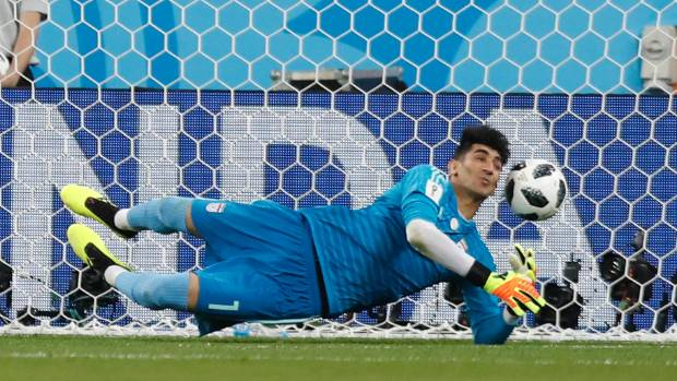 Iran goalkeeper Alireza Beiranvan who was once homeless saves a penalty from Cristiano Ronaldo