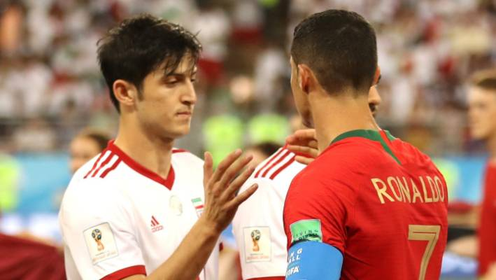 c4f3b08a6a3 Sardar Azmoun and Cristiano Ronaldo shake hands at the end of the Iran v  Portugal clash