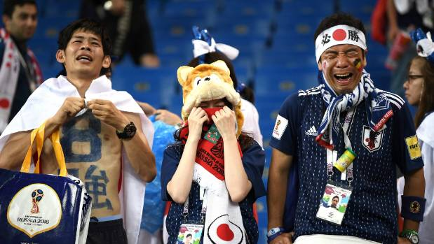 Japan fans in tears after their World Cup exit to Belgium.