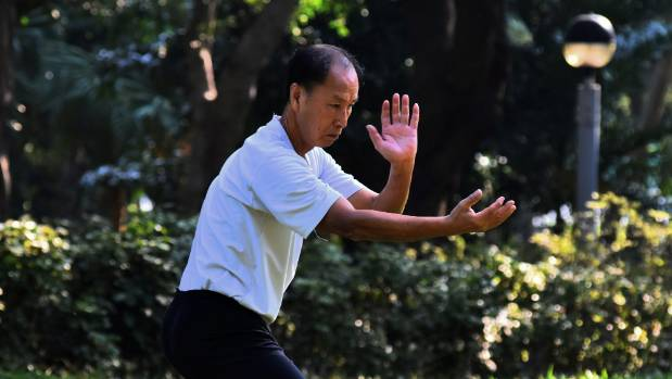 Qigong combines slow-motion movement and controlled breathing to align the body and mind.