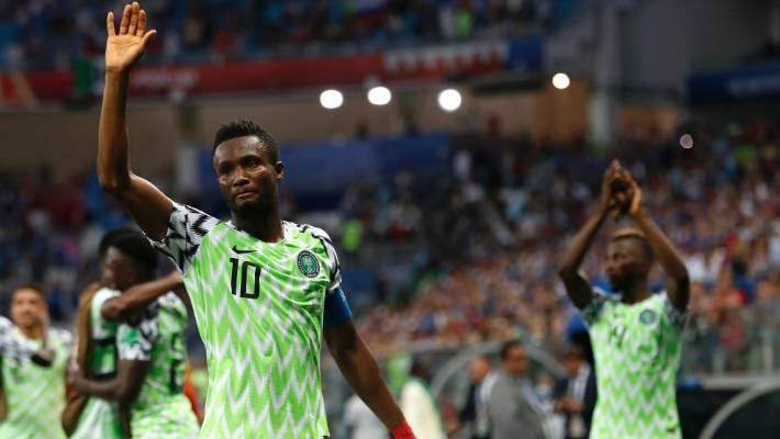 ff899c0549f Nigeria captain John Obi Mikel waves to his team s supporters after their  2-0 win