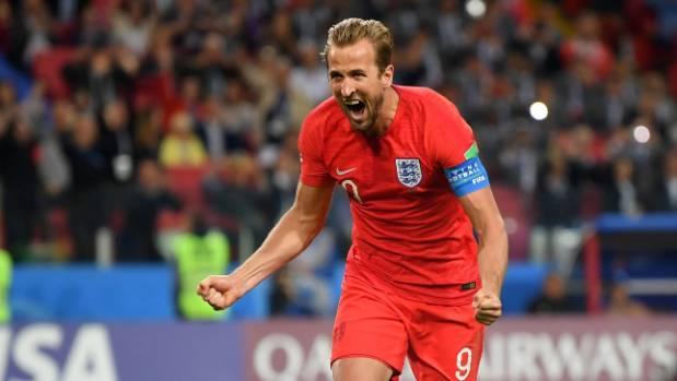 England captain Harry Kane celebrates converting a penalty against Colombia