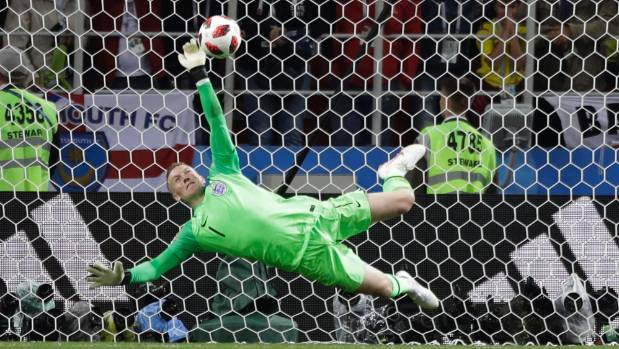Goalkeeper Jordan Pickford makes the huge save on Colombia's final penalty to set up England's win in the round of 16