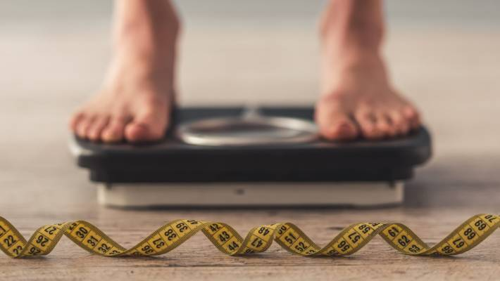 Bathroom scales won't suddenly get kinder when the definition of a kilogram changes