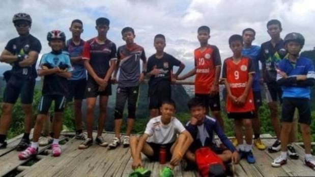 Ekkapol Chantawong, left, the assistant coach stuck in a cave with his team of football boys in Thailand.