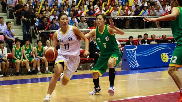 South and North Korean players play in their friendly basketball game in Pyongyang, North Korea.
