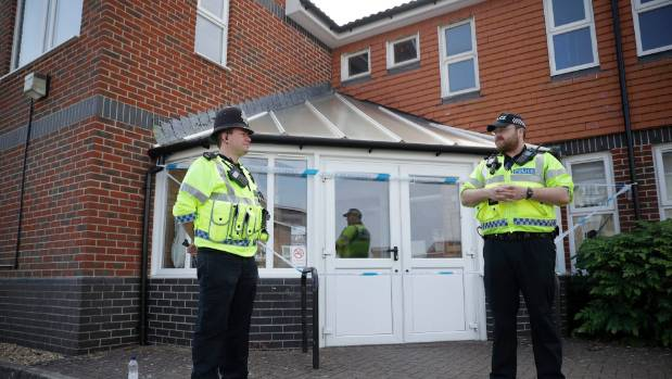 British police officers guards a cordon outside the Amesbury Baptist Centre church in Amesbury, England, after the ...