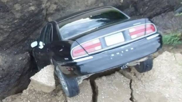 Sinkhole swallows up vehicle with teen still inside
