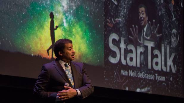 Astrophysicist Neil deGrasse Tyson speaks onstage in Texas. The stage show is also a podcast.
