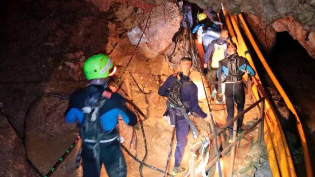 Rescuers begin missions to bring out last group from flooded Thai cave