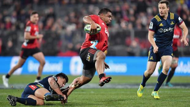 Crusaders hooker Andrew Makalio steps through the tackle of Rob Thompson, while Ben Smith (right) appears to be wondering if his life insurance policy is up to date.