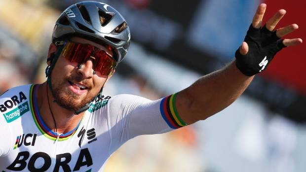 Peter sagan wins tour de france second stage stuff stage winner and new overall leader slovakias peter sagan celebrates as he crosses the finish line altavistaventures Image collections
