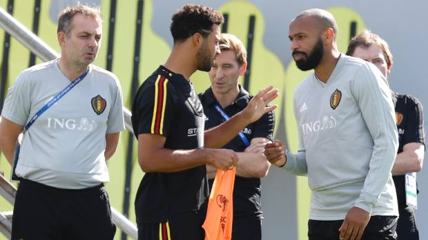 Belgium's Moussa Dembele makes a point to Thierry Henry at training