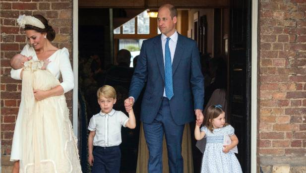 The Duchess of Cambridge holds Prince Louis, while Prince William holds the hands of Prince George and Princess ...