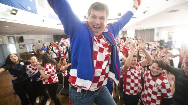Heartbroken but proud Croatia fans celebrate their 'heroes'