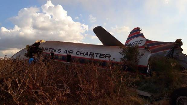 The 64-year-old plane crashed through a building before ending up in a field