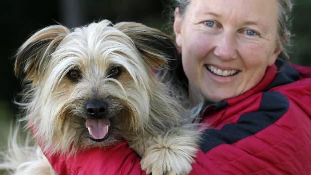 South Canterbury Dog Training Club vice president Lucinda Robertson with her 18-month-old pyrenean sheepdog Hero ahead ...