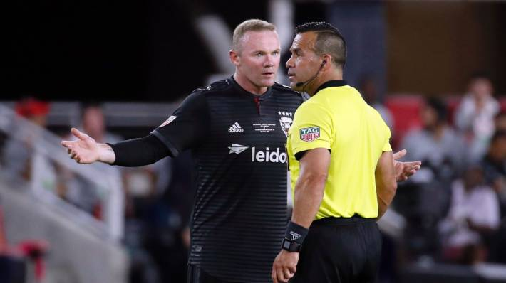DC United forward Wayne Rooney gets up close with the referee during his side's win over Vancouver Whitecaps.