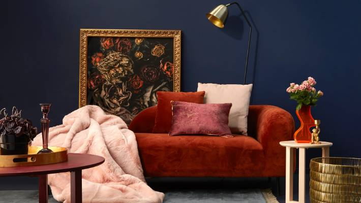 A Rusty Red Velvet Sofa And Lush Dusky Pink Throw Are Teamed With Metallic Finishes