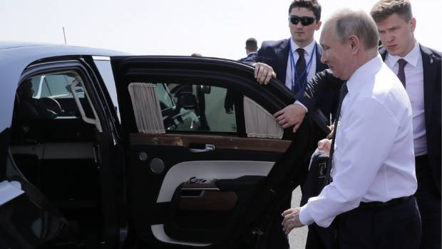 Russia's President Vladimir Putin gets into his limousine at Helsinki Airport to make his way to a meeting with US