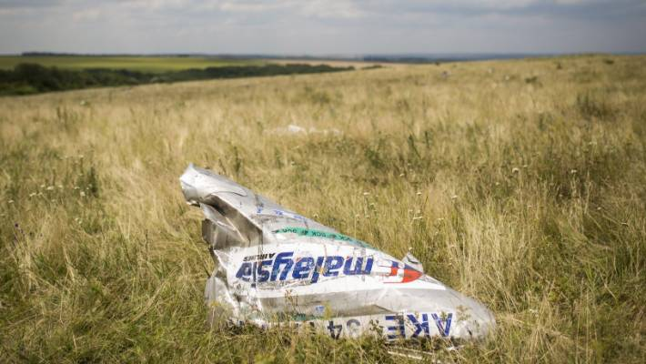 Wreckage from Malaysia Airlines flight MH17 lies in a field in Grabovo, Ukraine, in this photo from 2014.