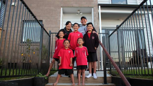 Proud homeowners Serenity Reti-Huch, back left, her husband Emil Reti-Huch, back right, and their six children ...