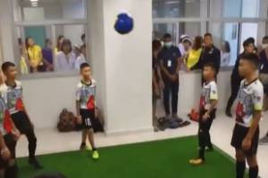 The Thai soccer team rescued from a cave play soccer with the Thai Navy Seals who helped save them.