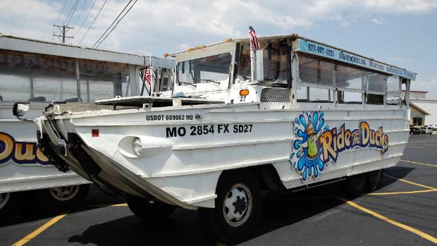 A duck boat sits idle in the parking lot of Ride the Ducks. The amphibious vehicle is similar to one of the company's