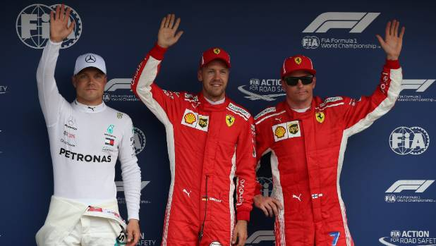 The top three qualifiers for the German Grand Prix Sebastian Vettel, Kimi Raikkonen and Valtteri