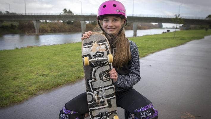 Skateboarder Eva Corkery, 10, with her board.