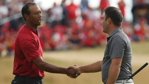 British Open champion Francesco Molinari of Italy is congratulated by Tiger Woods at the end of the fourth round