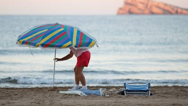 Beach umbrella impales woman