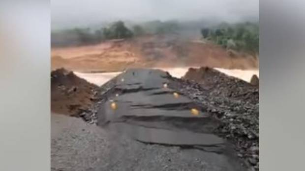 Fast-flowing water coming from the collapsed dam