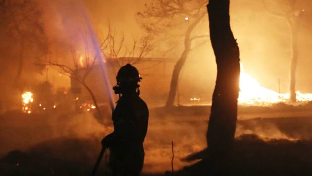 Greece wildfires: Athens firefighters shocked to find charred victims of fast-moving blaze