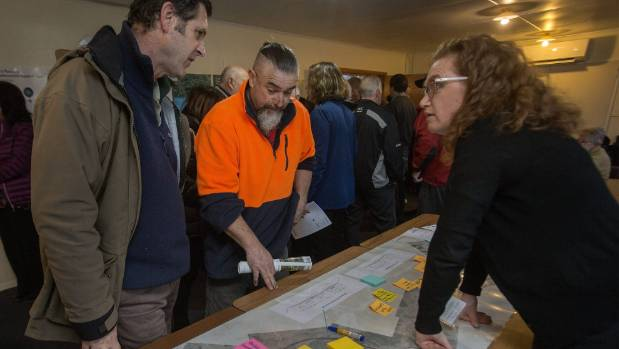 Woodville residents Ian Cumming and Marty Lean discuss the new road map with NZ Transport Agency traffic consultant Jo Healy.
