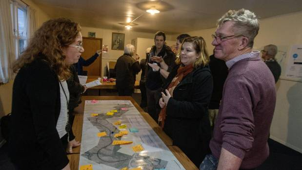 NZ Transport Agency traffic consultant Jo Healy discusses the map with Woodville residents Fiona Nesbit and Glenn McDean.