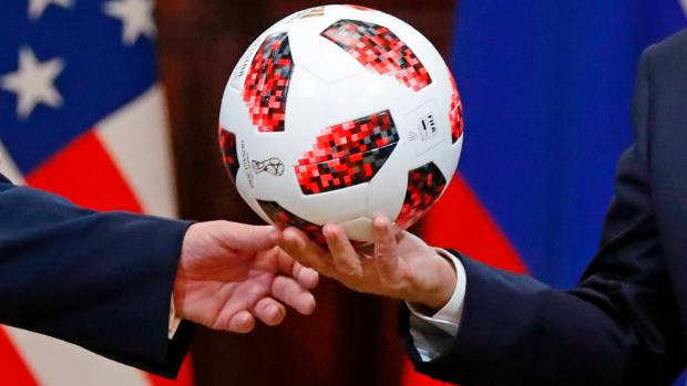 The ball Russian President Vladimir Putin gave to US. President Donald Trump appears to have an NFC chip in