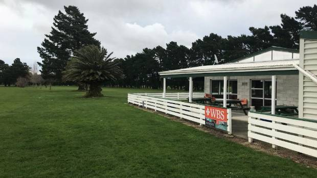 The Featherston Golf Club clubrooms next to the 18th hole.