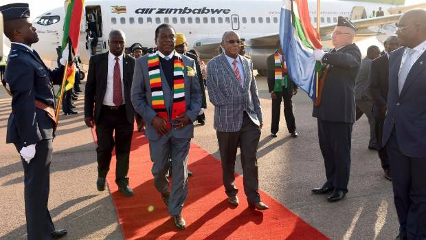A win for Zimbabwe's incumbent president, Emmerson Mnangagwa (centre, with scarf), is expected to leave the nation with ...