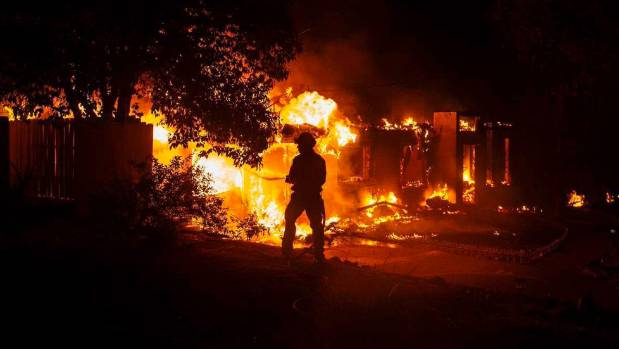 California wildfires cause injuries, continue to torch homes