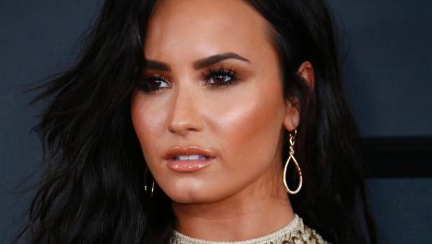 Demi Lovato's backup dancer begs fans not to attack singer's friends