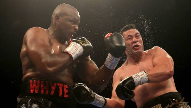 Dillian Whyte clobbers Joseph Parker with a left hook during their heavyweight fight.