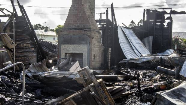 A chimney stands forlornly amid the rubble after the fire.