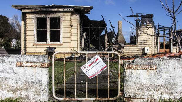 A safety sign on the gate of the Pātea house razed by fire on Sunday afternoon.