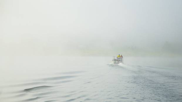 A foggy start to the day at Lake Peketirini in Huntly.
