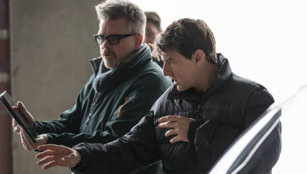 Director Christopher McQuarrie and Tom Cruise view material from Mission Impossible: Fallout