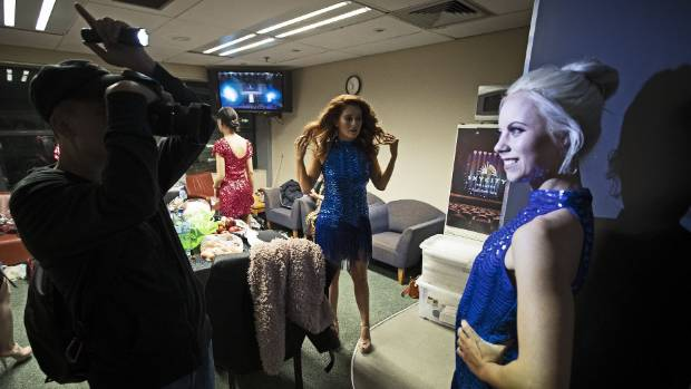 Backstage is practice for on-stage - and that means big smiles, eyes and teeth.