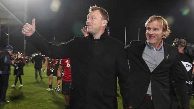 Wyatt Crockett, left, leaves the field with Crusaders coach Scott Robertson following the side's 37-18 Super Rugby final ...