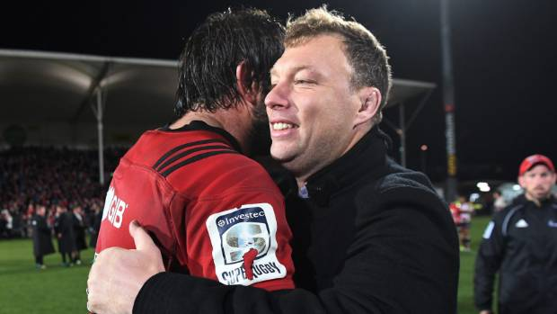 Departing Crusader Wyatt Crockett shares a hug with captain Sam Whitelock after the final win over the Lions.